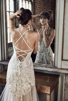 The limited edition Liberty gown from our LUXE collection features intricate, hand beaded Swiss embroidery and layers of unique, golden hued French lace.