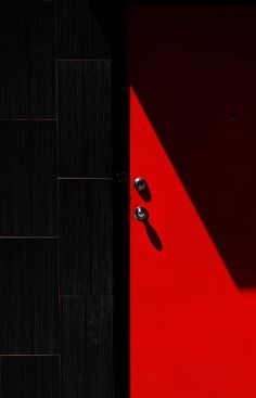 1x.com is the world's biggest curated photo gallery online. Each photo is selected by professional curators. Red and black by Jian Wang