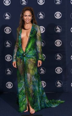 Jennifer Lopez wore one of the most memorable looks that the Grammy's has ever seen, a green Versace gown with a plunging neckline. // The Most Outrageous Grammy Looks of All Time
