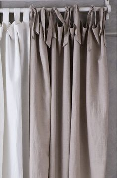 TIE - TOP CURTAINs  These curtains give the illusion of an unstructured, slightly feminine look. Again, they are suitable for either lined or unlined curtains. One can add detailing by using a contrasting fabric for the ties or edging. Just be warned, these curtains are better for windows that aren't in regular use as the ties don't move as easily. So perhaps use this decorative treatment to soften a room.