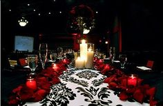 love this damask table runner, well accented with the red petals!