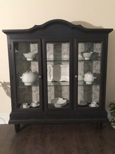 Refurbished curio cabinet , chalk painted soft black and lightly distressed,classic lines with modern touch.
