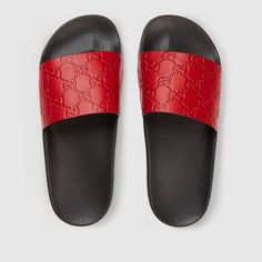 Shop the Gucci Signature slide sandal by Gucci. A Gucci Signature slide sandal. Made in heat debossed Gucci Signature leather resulting in a defined print with a firm texture. Red Sandals, Sport Sandals, Slide Sandals, Leather Sandals, Design Slide, Givenchy, Gucci Brand, Gucci Shoes, Gucci Gucci