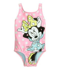 Fully lined swimsuit with a printed pattern. Low-cut back with a bow and shoulder straps joined at back.