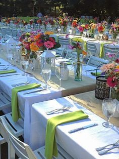 how to plan and implement large group dinner or wedding reception - 8'x4' tables, 3 lanterns, 5 vases of flowers, 6 votives per table,  Knitionary: The Belle of the Ball