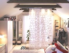 Use curtain panels as a soft room divider to create a private dressing area in your bedroom.