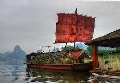 Photo of the Day: Red Sail at Sunset, Li River | Old river barge on the Li River, Guangxi, #China on October 9, 2010. (Stuck in Customs/Flickr)