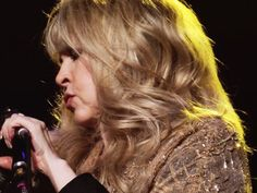 Stevie onstage  ~ ☆♥❤♥☆ ~    her golden tousled hair blending in with her sparkly shawl