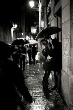 What is it about kissing in the rain? I mean, the umbrella seriously ruins it, but kissing in the rain...the streetlights like massive fireflies and you're both soaking... Mmm...