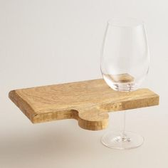 """Wood 4-Piece Puzzle Cutting Board - DETAILS & DIMENSIONS Crafted of wood 4-Piece set combines into large cutting board Use individual puzzle pieces as serving boards with wine glass holders World Market exclusive Made in India Combined: 18""""W x 10""""L"""