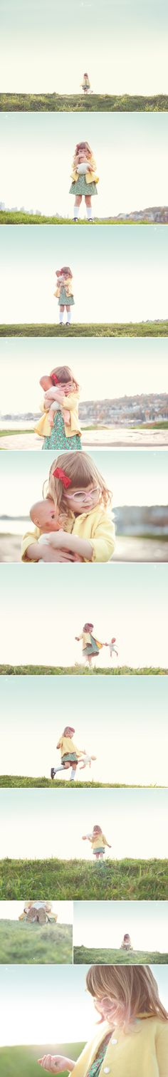 A girl and her baby doll...precious.