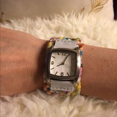 Multicolored watch Beautiful Braided fabric and faux white leather, silver face. Needs battery Jewelry