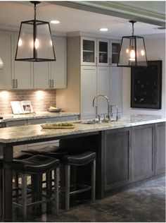 SaveEmail  Courtney & Aurora Design Group 5 Reviews Kitchen Remodel 30 Saves | 1 Question GTDM Photo Mid-sized eclectic single-wall eat-in kitchen in Houston with an undermount sink, shaker cabinets, dark wood cabinets, granite countertops, beige backsplash, subway tile backsplash, stainless steel appliances, limestone floors and an island. — Houzz Narrow island with storage and seating. Doesn't need a sink. Like the dark wood. — april