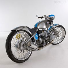 """This 1982 BMW R80 custom by Ian Solley of 7 Ages named """"Romeo 80"""" is radically different then most BMW customs. Solley is known as a Harley man and you can see all the influences in this build. The frame has been modified to a hardtail and the forks are from a Harley FXD. Fenders, side panels, seat section, and part of the gas tank are hand made custom pieces. While the engine was completely rebuilt it was left stock. One of a kind 23"""" rims were machined giving this bike a sweet stance…"""