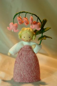Bleeding Heart~Flower Child~Waldorf Inspired BY KatjasFlowerfairys @Etsy: The little Bleeding Heart is made of 100 % wool-felt, fairy tale-wool and tricot material. The doll is approx. 13.5 centimeters high. The filling is sheep wool. Made to order. Ships from Germany. Price: $43.49 USD.