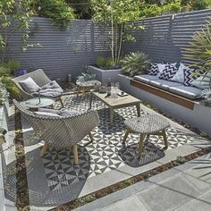 Small garden inspiration - This urban outdoor area was designed and constructed by in the UK. Love the tiled outdoor floor design and built in seating to fully utilise this tiny space creating a beautiful outdoor living area. Small Balcony Garden, Small Garden Design, Small Sunroom, Built In Seating, Floor Seating, Outdoor Lounge, Outdoor Seating, Outdoor Living Areas, Outdoor Spaces
