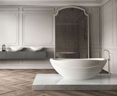 Kelly Hoppen for Apaiser - the layered design of the bath was inspired by the petals of a lotus flower.