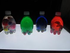 discovery/sensory bottles.  inside are pom poms, glitter, pony beads, water, clear glue, and food coloring!