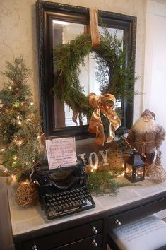 Vintage Christmas entry table, cool use of old typewriter Christmas Mantels, Noel Christmas, Merry Little Christmas, Primitive Christmas, Country Christmas, Winter Christmas, Vintage Christmas, Christmas Vignette, Christmas Music
