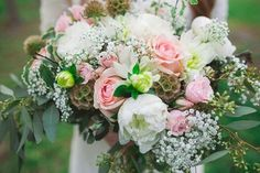 A bouquet of pink roses, white peonies, baby's breath, eucalyptus, and scabiosa pods | Photo by Kylee Ann Photography