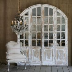 Loving these white-painted archway doors.