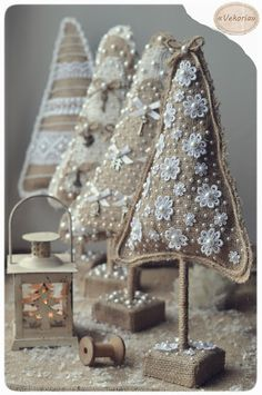 Christmas trees from burlap decorated with white (lace, pearls, bows and charms).