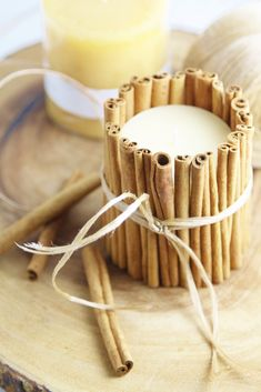 Decorate your table with DIY Cinnamon Wrapped Candles for the holidays