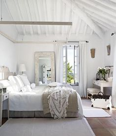 I like the general feel of this bedroom, how the overall theme is white and brightness.