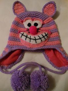 Cheshire Cat Earflap Hat Crochet Pattern by WistfullyWoolen, £2.89