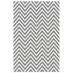 Chevron rug.  Product: RugConstruction Material: PolypropyleneColor: GrayFeatures:  Machine made0.39 Pile height Note: Please be aware that actual colors may vary from those shown on your screen. Accent rugs may also not show the entire pattern that the corresponding area rugs have.