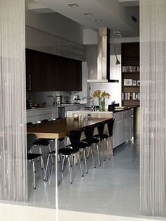 Brass range hood and metal mesh curtains at House of Jonny Detiger in New York #kitchen #dining