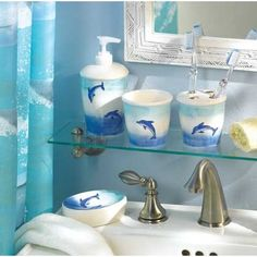 $24.95-Leaping dolphins in brilliant shades of blue provide the perfect aquatic accent to your bathroom!   Six piece set contains shower curtain and rings, soap dish, lotion dispenser, toothbrush holder, and tumbler.  Shower curtain is 100% polyester; decor pieces are ceramic. Curtain is machine was...