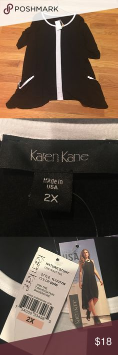 NWT-Karen Kane- black/white tunic-2X Great looking black/white tunic from Karen Kane- NWT- 2X-90/rayon 10/spandex- great comfort- 23 inches width 33 inches length- from smoke free home Karen Kane Tops Tunics