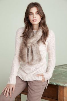 Fuzzy dreams  A furry scarf worn with a soft sweater and neutral pants is our idea of effortless elegance.