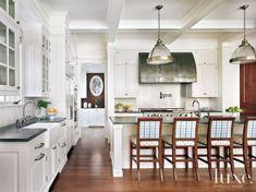 Designer Kylee Shintaffer designed this creamy kitchen's barstools using Cowtan & Tout's tartan plaid and Schumacher's woven truffles pattern.