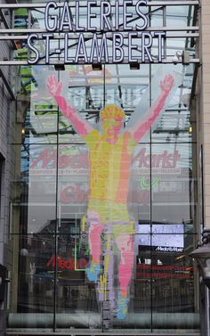 Artwork made from 450,000 post-its  Works of art consisting of 450,000 post-it notes arranged to form images of cyclists are on display at the Les Galeries Saint Lambert shopping mall in Liege, Belgium, ahead of the start of the Tour de France, June 27.