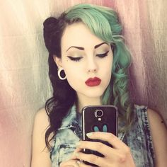 Black and green hair, red lips. Would look awesome on a Create A Monster witch doll.