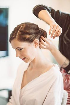 Putting the finishing touches on one of our brides Hair & Makeup WHAM Artists http://weddinghairandmakeupartists.com/
