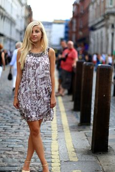 Evelina struts her stuff in London wearing the Kara Monochrome Print Tunic - we love her look!    #fashion #dress #tunic #evelinabarry #evelinasfashioncafe #love #embellisheddress
