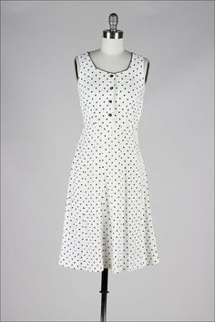 White linen dress with navy blue polka dots (without jacket), c. 1940s.