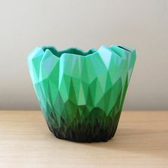 A watering can and an action figure were among the everyday objects scanned and distorted by designerMatthew Plummer Fernandezto create these faceted and richly coloured 3D printed vessels.        The objects are based on 3D scans of a watering can, a Power Ranger action figure, a spray bottle, a dolphin-shaped lamp and a 19th century vase.
