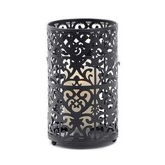 Let the intricate pierced body style of this black metal hurricane create beautiful candlelit silhouettes along your wall. #kirklands