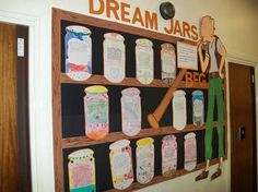 "Students created dream jars from Roald Dahl's story ""The BFG.""   This teacher has created a bookshelf bulletin board display, along with a large drawing of the BFG, to showcase her students' dream jar projects."