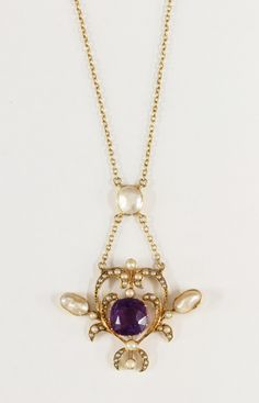 An Edwardian amethyst split pearl and blister pearl pendant, £200