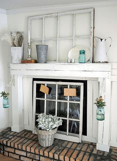 Old fireplace cover up decor.. And I'm obsessed with white/turquoise so this just fits wonderfully.