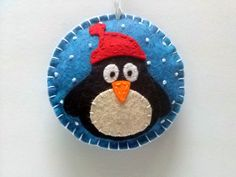 Felt christmas ornament - Penguin snowing snowglobe ornament/ wool blend felt  This listing is for 1 ornament   Size about 8 cm Material wool blend felt  Handmade from felt with high precision and great care.  Please note that ornaments are decorated on one side only. Other side is solid blue. Santa ornament is a bit larger than reindeer, penguin and snowman ornaments  For more Christmas ornaments visit my Christmas section https://www.etsy.com/shop/DusiCrafts?section_id=15537694…