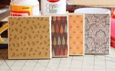 Bathroom tile coasters with scrapbook paper and modge podge. There are also 52 weeks of DIY crafts on this great blog!
