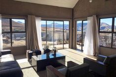 Ridge Rd Cottage - Clarens Accommodation. Pond Covers, Aluminium Sliding Doors, Bedroom With Bath, Queen Room, Pet Friendly Accommodation, Free State, Wrought Iron Gates, Bespoke Kitchens, Entrance Gates