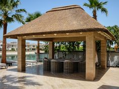The Cape Reed design team has developed a modern contemporary white wash paint application for all timber structures. Backyard Pavilion, Backyard Gazebo, Thatched House, Thatched Roof, Built In Braai, Gazebo Roof, Hut House, African House, Palm Jumeirah