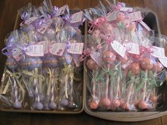 Baby Rattle Cake Pops Tutorial - the tutorial is now blocked on youtube, but picture gives an idea on packaging the baby rattles.